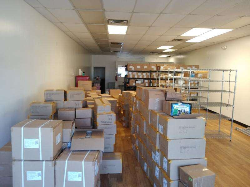 Setting up shelves and getting boxes on shelves.